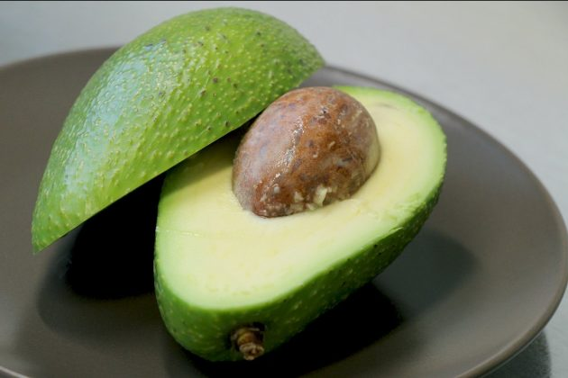 Halve the avocado and remove the core